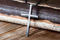 Silver Christian cross on bible Stock Image
