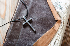 Silver Christian cross on bible Royalty Free Stock Photo
