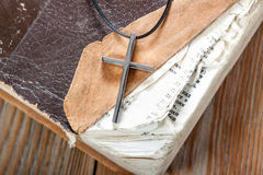 Silver Christian cross on bible Royalty Free Stock Photography