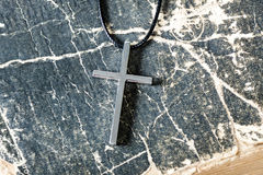 Silver Christian cross on bible Stock Photography