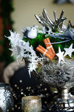 Silver Christmas arrangement. Close up of a beautiful christmas  arrangement or table piece in a large silver bowl. Shallow dof Stock Image