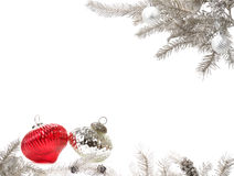 Silver Christmas arrangement. Branches of a silver Christmas tree arranged with baubles to create a frame Stock Photos