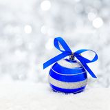 Silver Christmas background with blue bauble Royalty Free Stock Photo