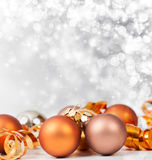 Silver Christmas background with Christmas balls. Silver Christmas background with golden Christmas balls and decorations stock image
