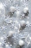 Silver Christmas background. Curly ribbon with decorative balls and snowflakes. stock photo