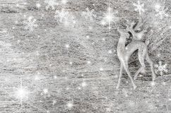 Silver Christmas background. Decorative deer and snowflakes. royalty free stock photos