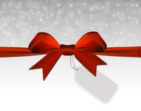 Silver Christmas background with red bow with price tag Stock Photos