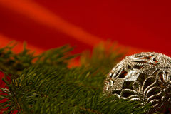 Silver christmas ball. With pine branch Royalty Free Stock Images