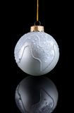 Silver Christmas ball on black background with reflection Royalty Free Stock Images