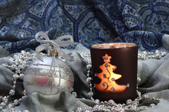 Silver Christmas ball and candle royalty free stock images