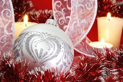 Silver Christmas Ball and Candles. Silver Christmas Ball, Ribbons and Burning Candles Stock Image