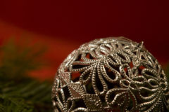 Silver christmas ball (close-up). Silver christmas ball with pine branch Royalty Free Stock Photo