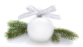 Silver Christmas ball and fir branches isolated on white Stock Photo