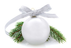 Silver Christmas ball and fir branches isolated on white Royalty Free Stock Photos