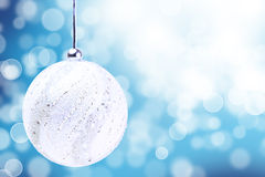 Silver Christmas Ball Ornament Over Elegant Grunge blue. And white Christmas Light Bokeh & Crystal Background Royalty Free Stock Photos