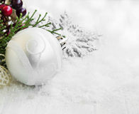 Silver Christmas Ball with Ornaments and Glitter in the Snow Stock Image