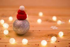 Silver Christmas ball. Red hat. Lights. Snowflake royalty free stock images