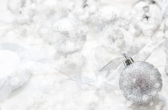 Silver Christmas ball with ribbon on white spakles bokeh light b Stock Image