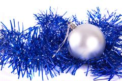 Silver christmas ball with tinsel. Isolated on white Stock Images