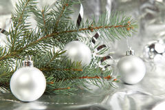 Silver christmas balls. With a christmas tree on the silver background stock photo