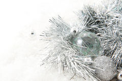 Silver christmas balls. With a silver tinsel and snow stock image