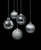 Silver Christmas balls. Five silver decoration Christmas balls hanging black background isolated stock image