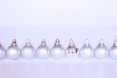 Silver christmas balls. Row of silver christmas balls stock image