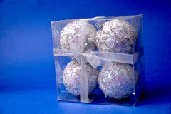 Silver christmas balls on blue background Royalty Free Stock Photography