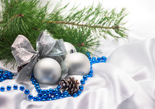 Silver Christmas balls with bow with pine branches Royalty Free Stock Photo