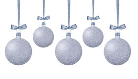 Silver Christmas balls with bow on ribbon isolated on white. Background royalty free stock photo