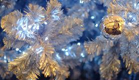 Silver Christmas balls on branch Christmas tree. One silver Christmas balls on branch Christmas tree royalty free stock photography