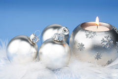 Silver christmas balls and candle Stock Photos