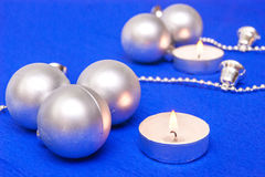 Silver Christmas balls and candles Stock Photos