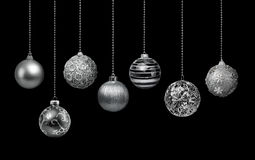 Silver Christmas balls collection. Seven silver decoration Christmas balls collection hanging, black background isolated stock photography