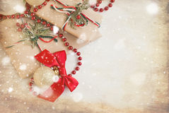 Silver Christmas balls and gifts on wooden table Stock Image