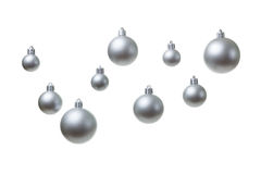 Silver Christmas balls. Glass coated with silver Christmas balls hanging isolated on a white background stock image