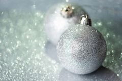 Silver christmas balls. On glitter background with white copy space royalty free stock photography