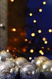 Silver Christmas Balls with lights. Silver Christmas Balls with golden lights on blue Stock Photography