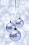 Silver Christmas Balls Ornament Over Elegant Grunge. Blue and white Christmas Light Bokeh & Crystal Background royalty free stock photo