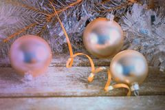 Silver Christmas balls and pine branch. Merry Christmas and Happy New Year. Silver Christmas balls and pine branch on wooden background. Merry Christmas and royalty free stock photo