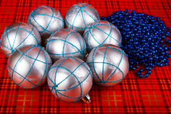 Silver Christmas balls. On a red background stock image
