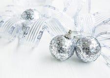 Silver Christmas balls and ribbon decoration. Festive silver Christmas decoration with balls and ribbon stock photography