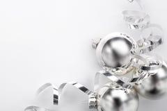 Silver Christmas balls and ribbon Stock Images