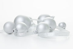 Silver Christmas balls. With ribbon on a white background stock images