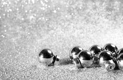 Silver christmas balls on shining glitter background Royalty Free Stock Images