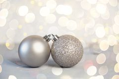 Silver Christmas balls on shiny background stock images