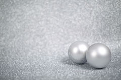 Silver christmas balls. On shiny glitter background close-up stock images