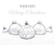 Silver christmas balls. On the snow background royalty free stock image