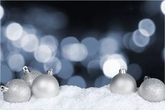 Silver Christmas balls on snow background. Balls christmas silver white background gift isolated stock photo