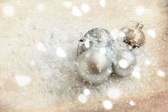 Silver Christmas balls on the snow, bokeh, christmas card Royalty Free Stock Photo